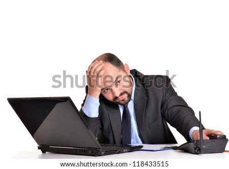 portrait of a beautiful adult businessman with a computer