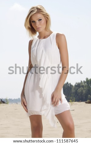 portrait of a beautiful adult sensuality blonde woman - stock photo
