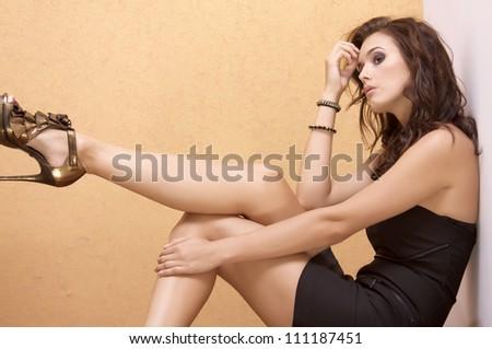 portrait of a beautiful adult sensuality brunette woman - stock photo