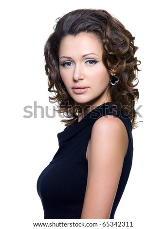 Portrait of a beautiful adult sexy woman with curly hair. Model posing over white background - stock photo