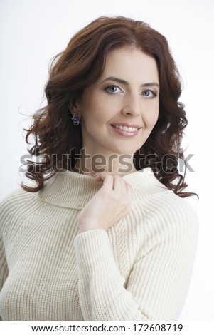 Portrait of a beautiful adult woman on a white background - stock photo