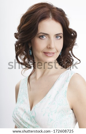 Portrait of a beautiful adult woman on a white background