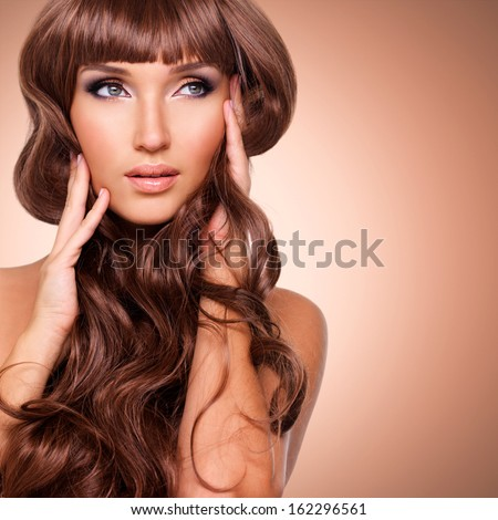 Portrait  of a beautiful  adult woman with long red hairs. Closeup face  with curly hairstyle, studio - stock photo
