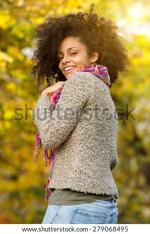 Portrait of a beautiful african american woman smiling outdoors