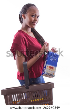 portrait of a beautiful African woman shopping for groceries and posing on an isolated background - stock photo
