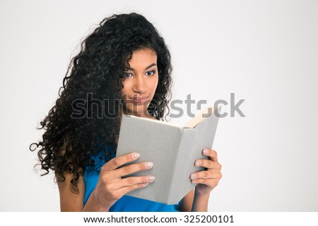 Portrait of a beautiful afro american woman reading book isolated on a white background - stock photo