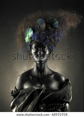 Portrait of a beautiful alien lady with an unusual hairstyle - stock photo