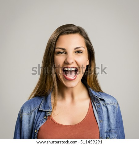 Portrait of a beautiful and happy woman laughing