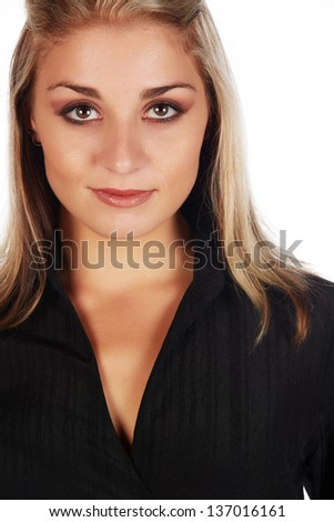 Portrait of a beautiful and sexy young adult caucasian businesswoman with honey blonde hair and brown eyes with natural make-up