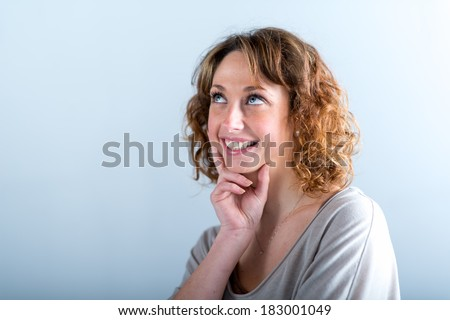 portrait of a beautiful and sexy young woman on light background