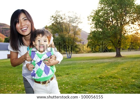 Portrait of a Beautiful Asian Mother and her son - stock photo