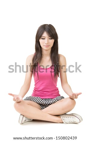 Portrait of a beautiful asian woman in yoga pose. On the white background. - stock photo
