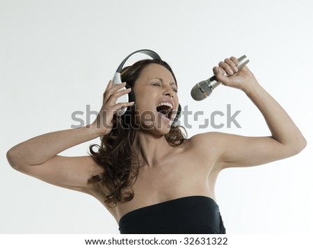 portrait of a beautiful asian woman on isolated white background singin - stock photo