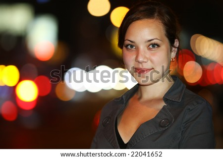 Portrait of a beautiful Asian young woman at night. Shallow DOF. - stock photo