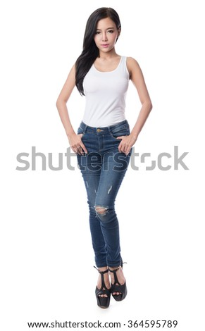 Portrait of a beautiful asian young woman in a blue jeans and white shirt, isolated on white background - stock photo