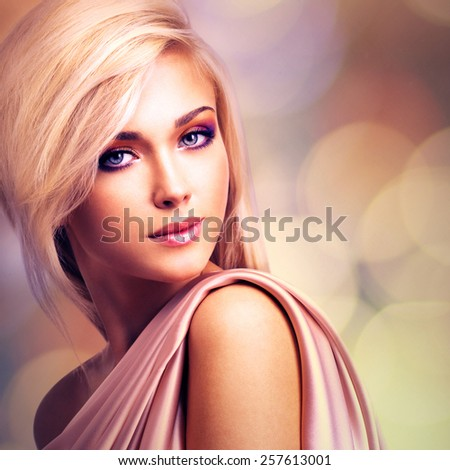 Portrait of a beautiful attractive woman with pink silk posing at studio. - stock photo
