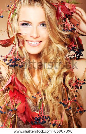 Portrait of a beautiful autumn woman. - stock photo