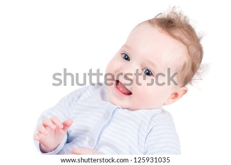 Portrait of a beautiful baby girl in a blue sweater, isolated