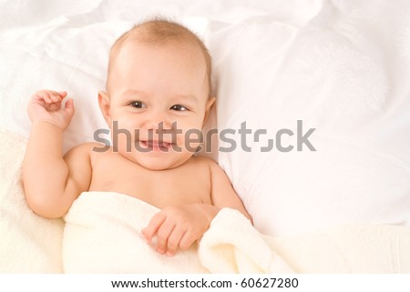 portrait of a beautiful baby on a white - stock photo