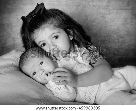 Portrait of a beautiful black and white two sisters processing - stock photo