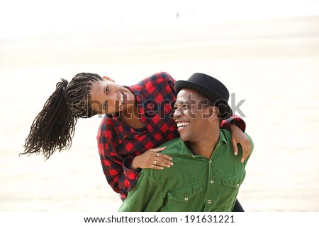 Portrait of a beautiful black couple smiling outdoors - stock photo