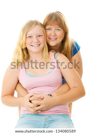 Portrait of a beautiful blond, blue eyed mother and teenage daughter.  Isolated on white. - stock photo