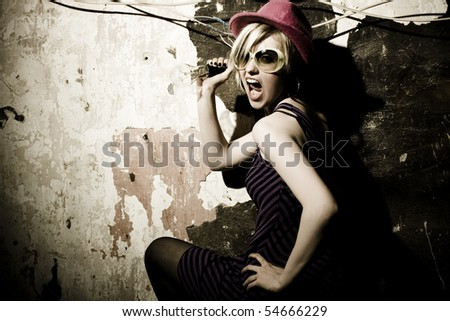 portrait of a beautiful blond girl with hat - stock photo