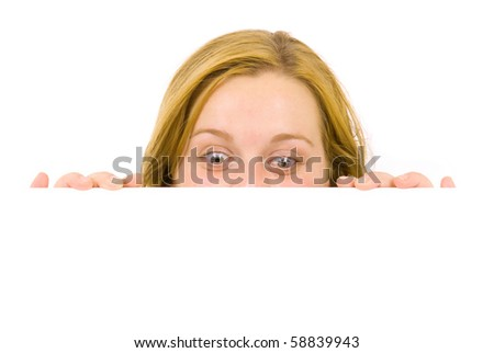 Portrait of a beautiful blond woman holding a blank billboard - stock photo