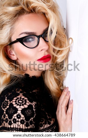 Portrait of a beautiful blond woman  with amazing cat  green eyes of sweet red lips in a sensual hairstyle with a sexy look with glasses