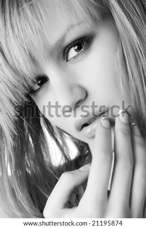 portrait of a beautiful blond woman with manicure