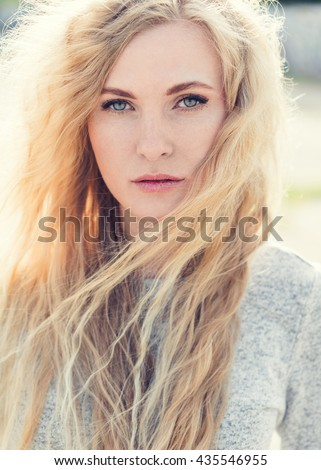 portrait of a beautiful blonde close-up on a sunny day in the city