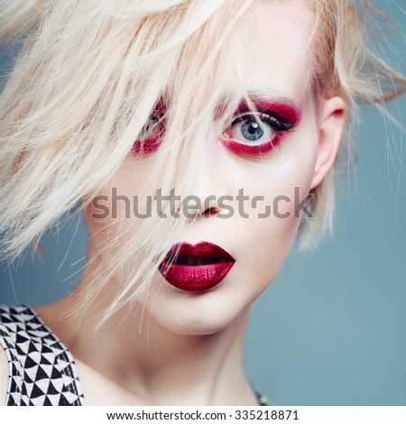 Portrait of a beautiful blonde girl in a studio with a nice makeup