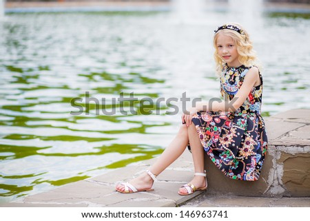 portrait of a beautiful blonde girl in park