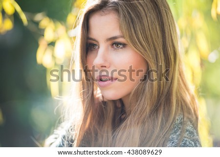 Portrait of a beautiful blonde girl in the garden