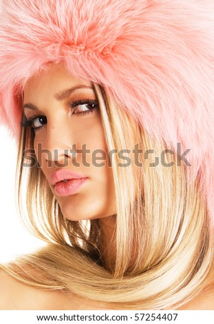 Portrait of a beautiful blonde in a pink fur hat