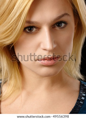 Portrait of a beautiful blonde, isolated over black - stock photo