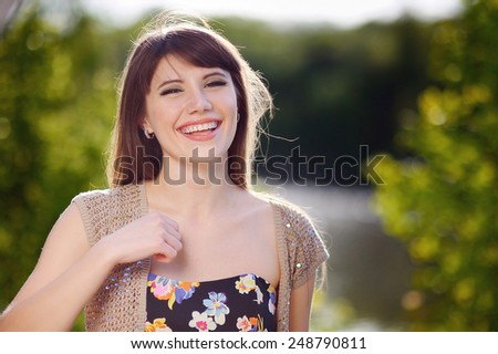 portrait of a beautiful blonde outdoors in the park. - stock photo