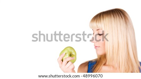 Portrait of a beautiful blonde who looks at the apple