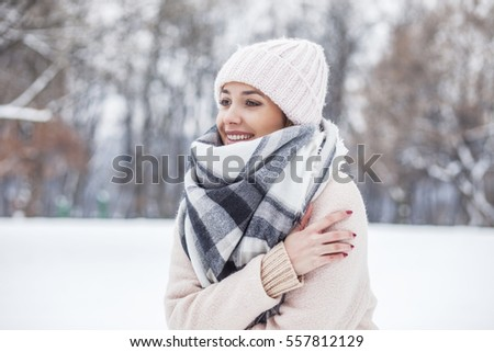 Portrait of a beautiful blonde woman in in the snow