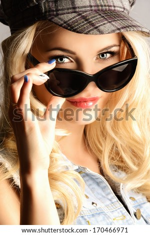 Portrait of a beautiful  blonde woman in sunglasses. - stock photo