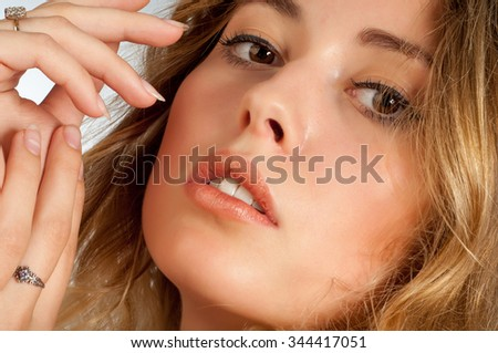 Portrait of a beautiful blonde woman. Portrait of a stunning blonde beauty. magnificent portrait of a beautiful young woman with perfect skin closeup. - stock photo
