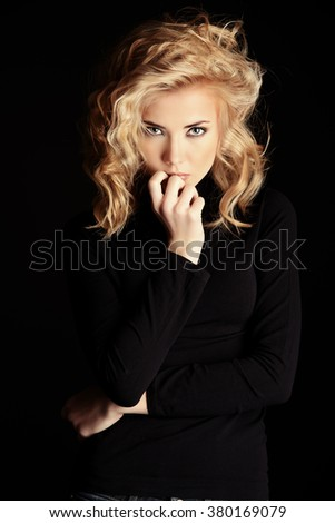 Portrait of a beautiful blonde woman with stunning eyes over black background.  Beauty, fashion. Make-up, smoky eyes. - stock photo