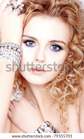 portrait of a beautiful blonde young woman with bracelets - stock photo