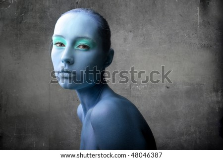 Portrait of a beautiful blue-colored woman - stock photo