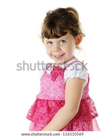 Portrait of a beautiful blue-eyed, brunette preschooler in a vibrant pink dress.  On a white background.