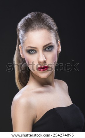 Portrait of a beautiful blue eyed woman on black background