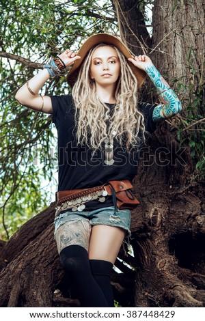 Portrait of a beautiful boho style girl in the wild wood. Boho, hippie fashion shot. - stock photo