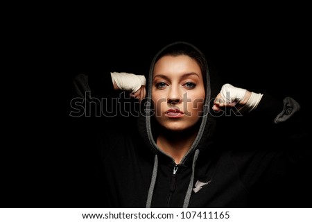 Portrait of a beautiful boxer girl with white bandage on hands
