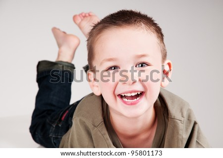 portrait of a beautiful boy smiling - stock photo