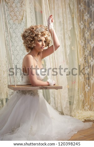 Portrait of a beautiful bride in sitting on the floor - stock photo